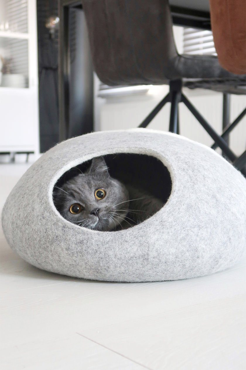7d770a6c It's no secret that cats love to hide and crouch in comfy spaces. One of  our most popular items, this cat cave is the perfect spot for your cat to  spy and ...