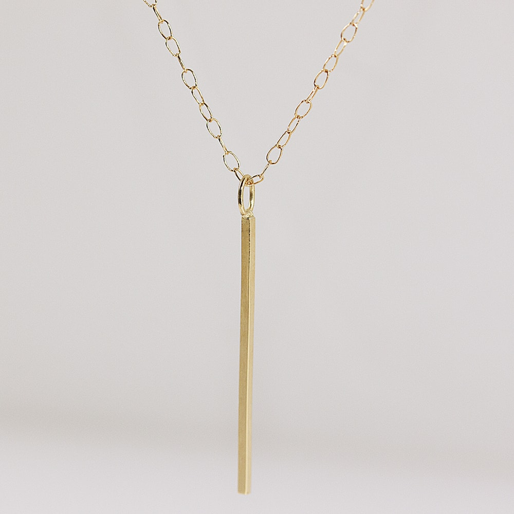 shop inspirational necklace vertical pendant bar prasada namaste gold jewelry
