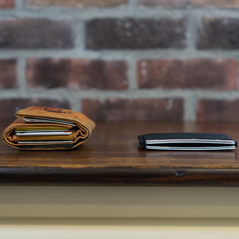 Fat wallet next to thin Infinity Wallet