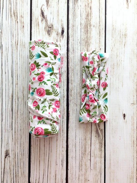 Floral newborn swaddle with matching headband