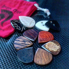 wooden guitar picks, bone picks, horn picks, handmade guitar pick, plectrums, iron age, how to choose a guitar pick