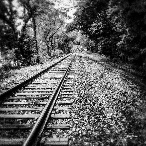 Black & White view of a train track reaching into infinity.