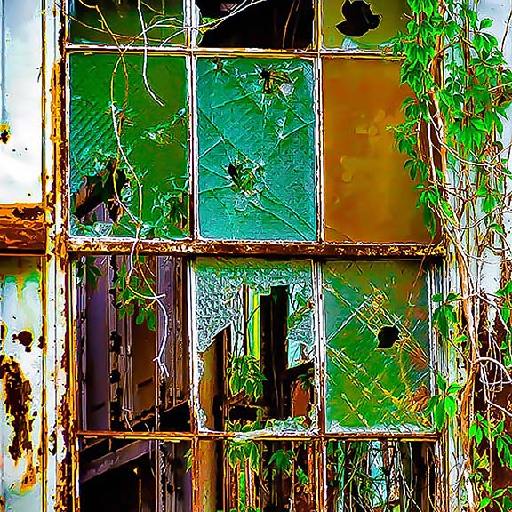 Window in an old dilapidated building, reimagined as stained glass.