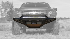 Addictive Desert Designs 10-14 Ford F-150 Raptor HoneyBadger Front Bumper w- Winch Mount