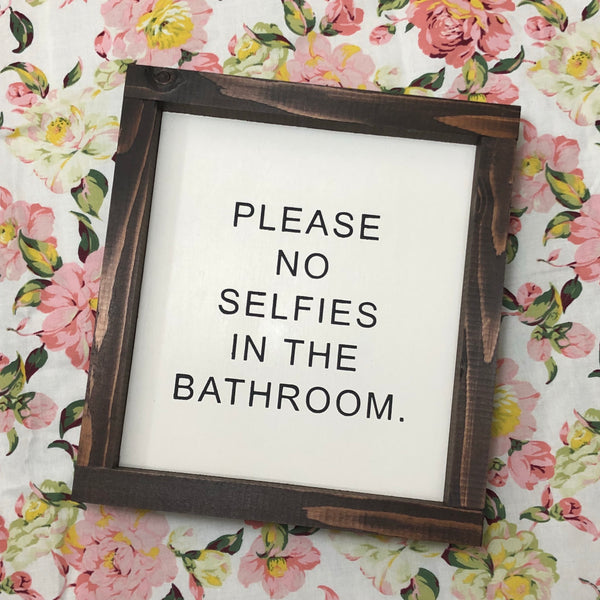 Please no selfies in the bathroom