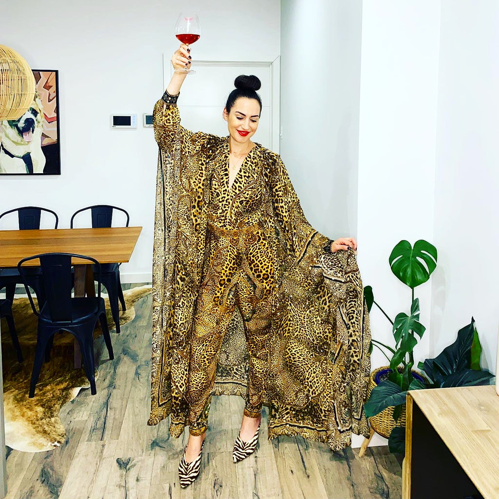 How to style Camilla capes and long layering pieces