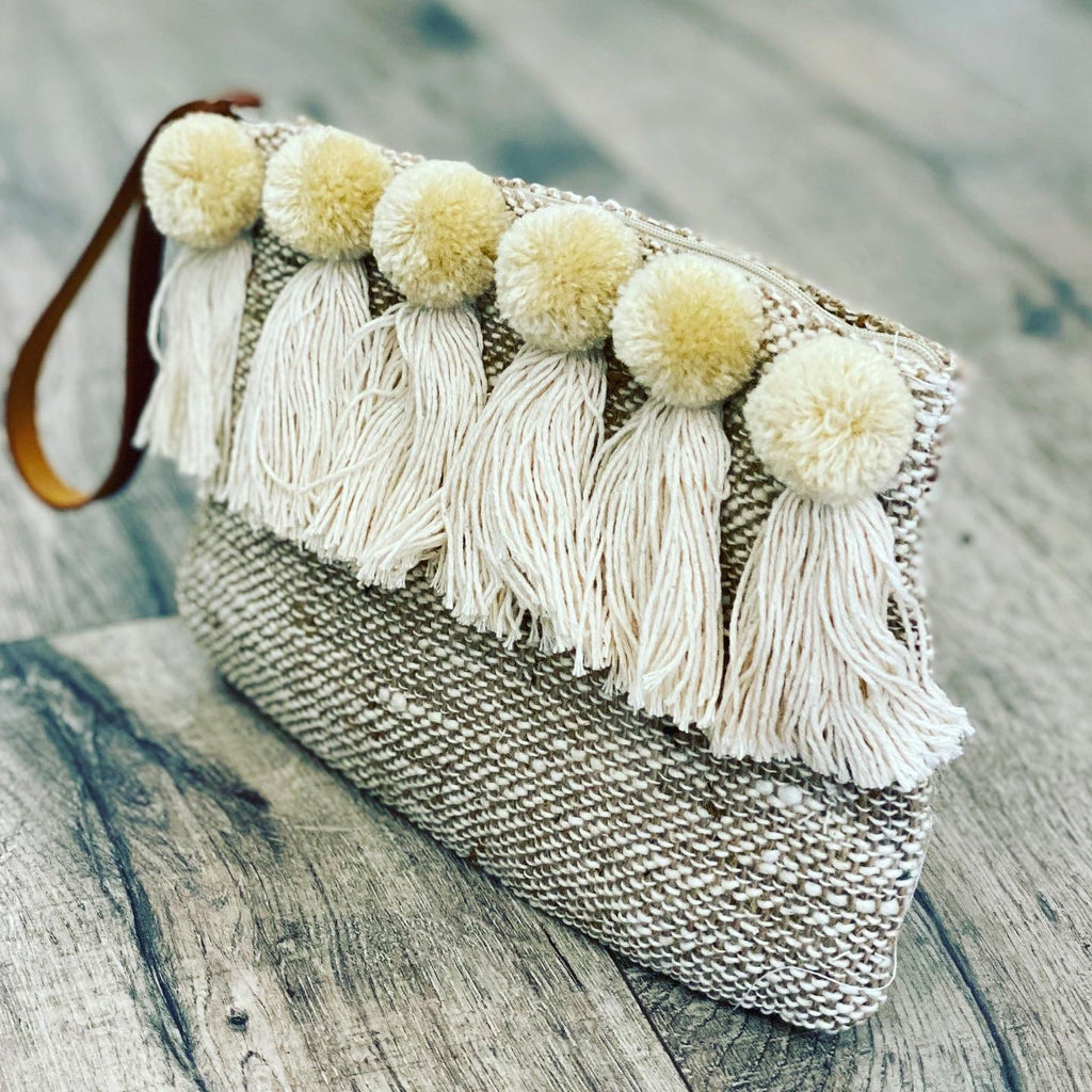 The Bali Artisan Collection Handwoven Pom Pom Clutch