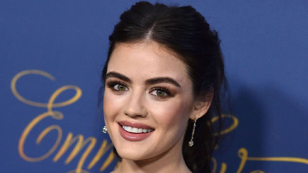 Lucy Hale photograph taken for a J-14 article about her new Atticus Poetry Tattoo from her favorite poem