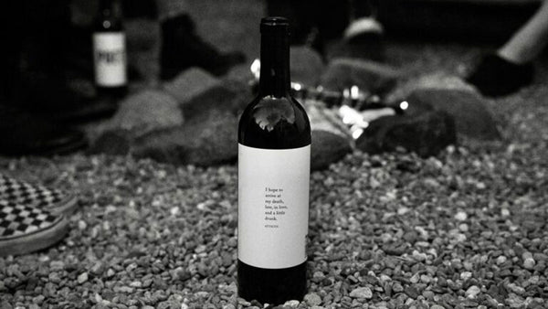 a bottle of Lost Poet red wine at a party with friends and family during the holidays