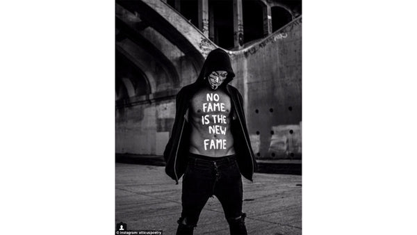 """Atticus poetry photo of atticus with """"no fame is the new fame"""" written on his chest - Atticus poetry gifts, clothing, and books online are not provided by Rupi Kaur"""