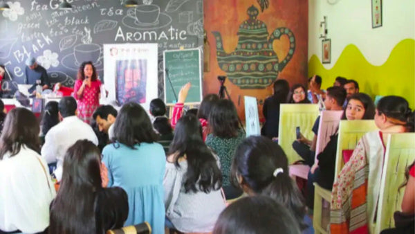 Children in a classroom in India discussing poetry and modern online poets like Atticus