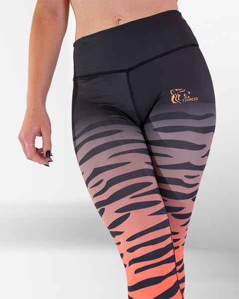 Tigress Apparel Coral & Black Tiger Stripe Leggings On Female Model. Cropped view with focus on waist.