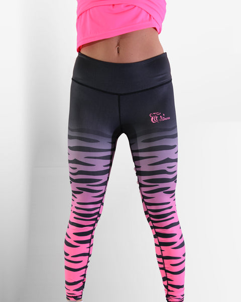 Tigress Apparel Pink & Black Leggings On Female Model. Cropped view of leggings with focus on the waist. Modelled with a pink gym top.