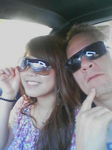 Cute little Asian girl with Handsome Man in Sun Glasses