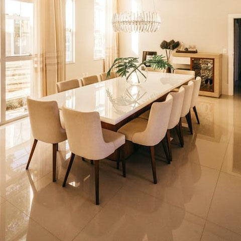 a modern dining room with lighting and furniture
