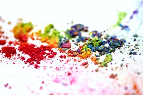 Coloured Powders on White Canvas