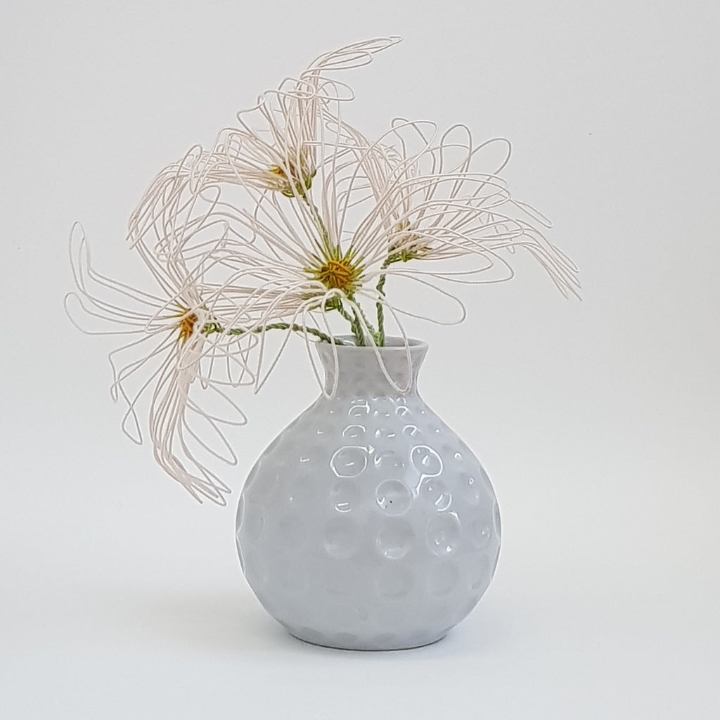 Large dyed wire daisies