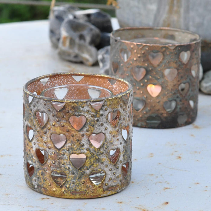 Antique metal votive candle holder
