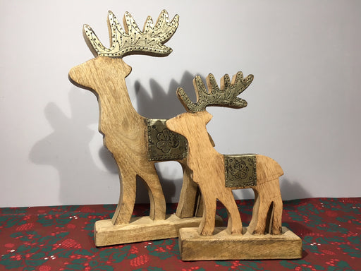 Wooden reindeer ornaments with silver saddles and antlers