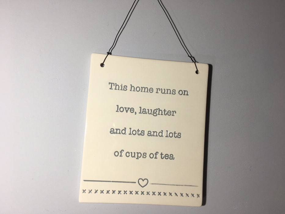 This home runs on love, laughter Hanging Plaque