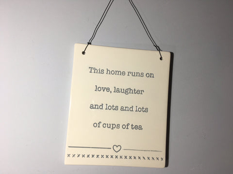 Home Plaque - This home runs on love, laughter and lots of cups of tea