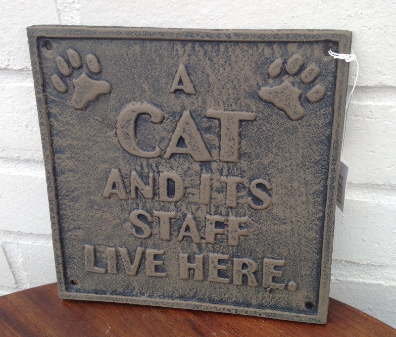 Cast Iron Cat Sign - A CAT AND IT'S STAFF LIVE HERE