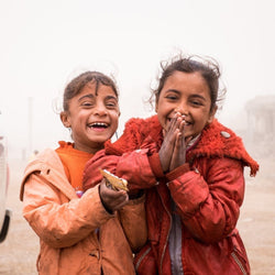 Laughing refugee kids smiling - help where needed most donation to Preemptive Love Coalition