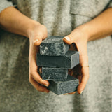 Woman holding refugee made charcoal soap