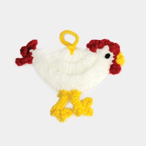 Hand sewn and knit refugee made chicken ornament from yarn in Iraq