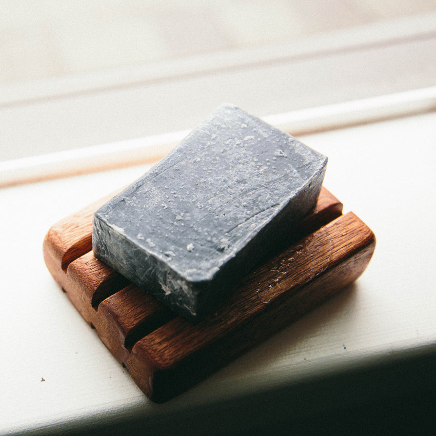 Manly Activated Charcoal Olive Soap on Redwood soap dish