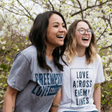 women laughing in preemptive love logo shirts