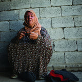 Refugee woman knitting washcloths