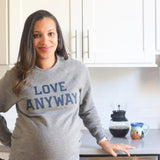 Woman wearing Love Anyway Sweatshirt, comfy sweater!