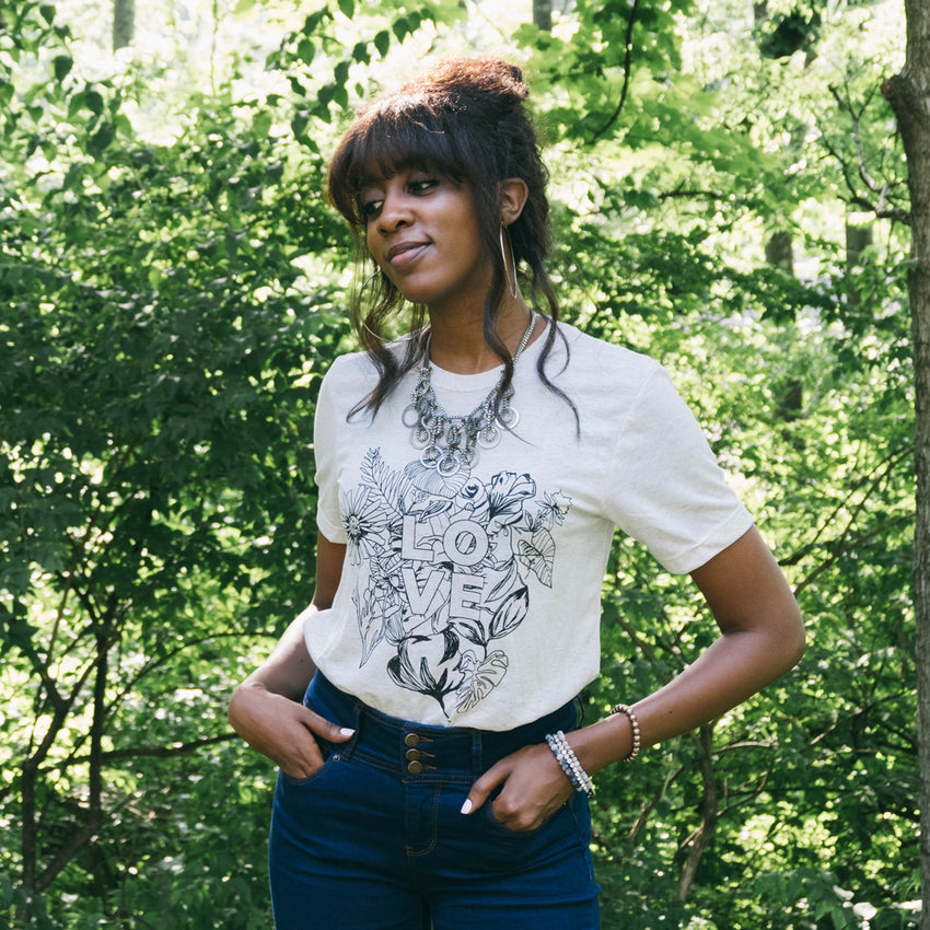 Woman wearing Love Botanical Shirt for Preemptive Love Coalition - Woman's Fashion & Style
