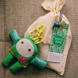 beautiful green peace doll great gift for kids in cotton bag with door hanger