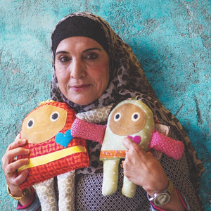 Woman holding knit dolls in Israel/Palestine