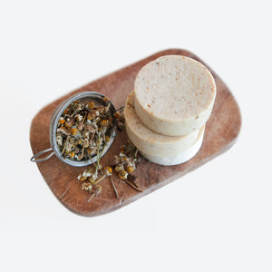 Chamomile Olive Oil Soap made by refugee women in iraq on with chamomile flowers