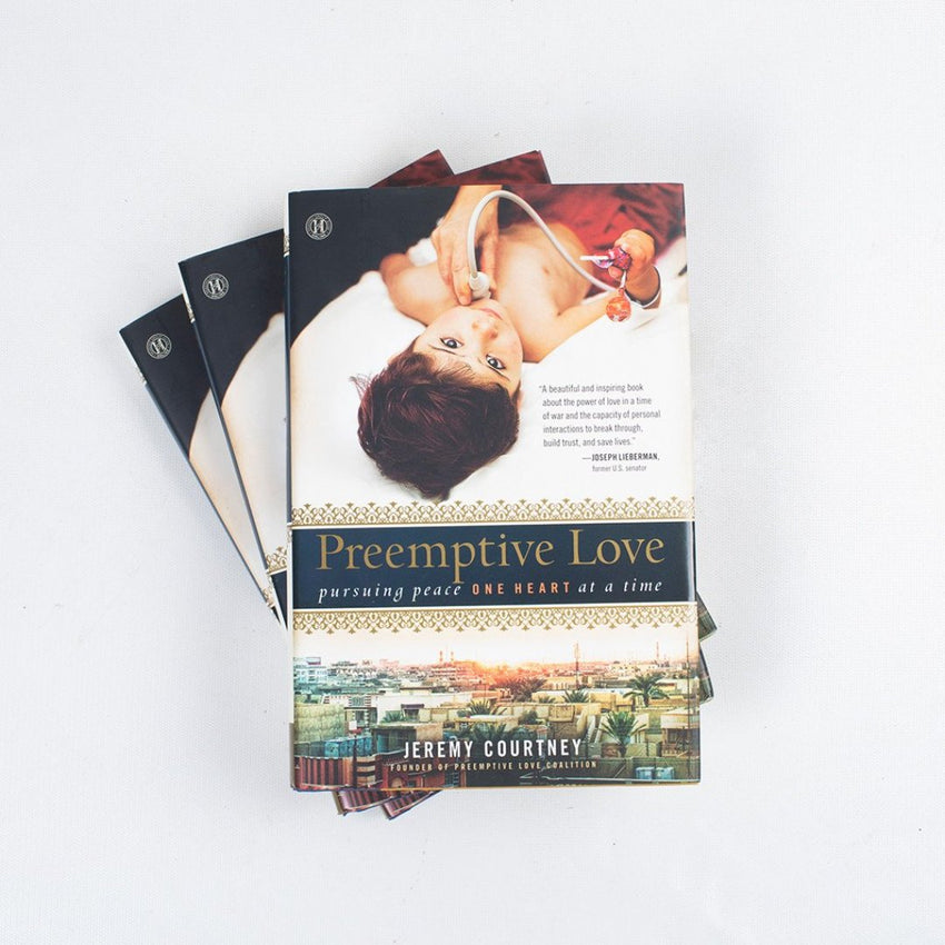 stacked books the story of preemptive love coalition by jeremy courtney