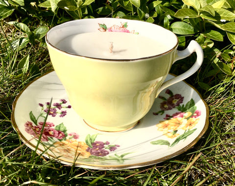 yellow vintage tea cup and sauce candler
