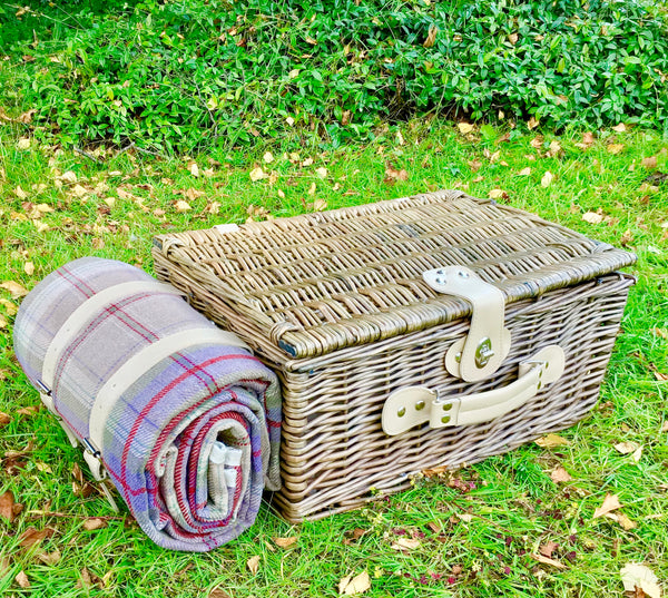 picnic hamper with tweed rug