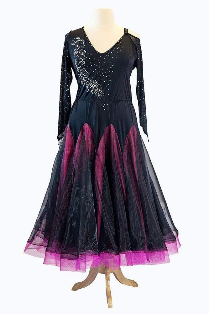 Smooth black gown with striking pink underskirt.