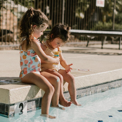 Kids at the pool applying Sunscreen with SPF