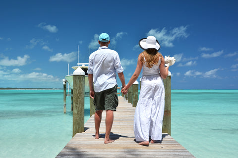 man and woman walking on a pier