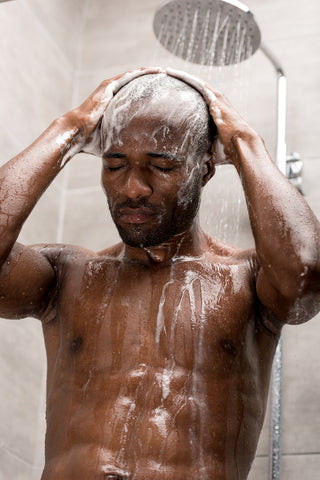 Man shampooing hair to deal with adult cradle cap