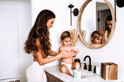 Mom applying lotion to child that contains argan oil