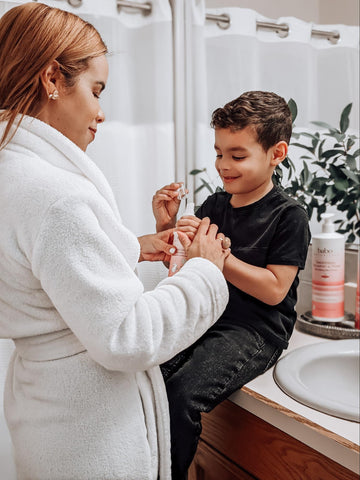 Mom giving son products to help prevent ashy skin