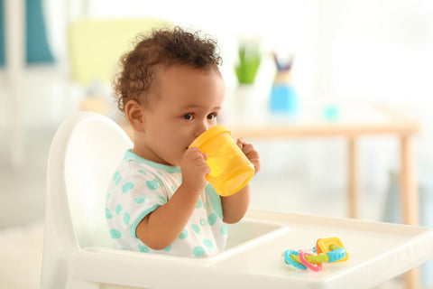toddler drinking from a sippy cup