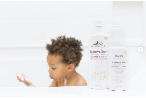 baby taking a bath with Babo Botanicals's Calming Shampoo, Bubble Bath & Wash