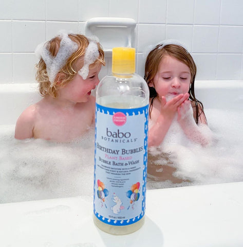 Siblings during bath time with Babo Botanicals bubble bath & wash