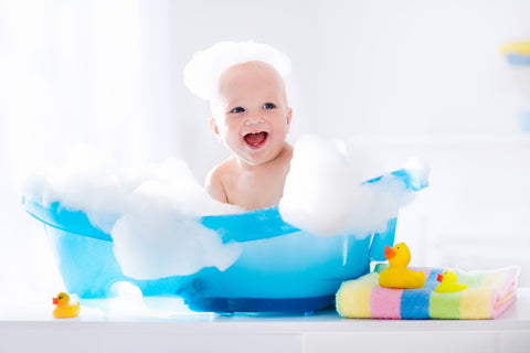 baby in baby bath tub for bubble bath